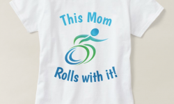 fun colorful wheelchair with the words this mom rolls with it